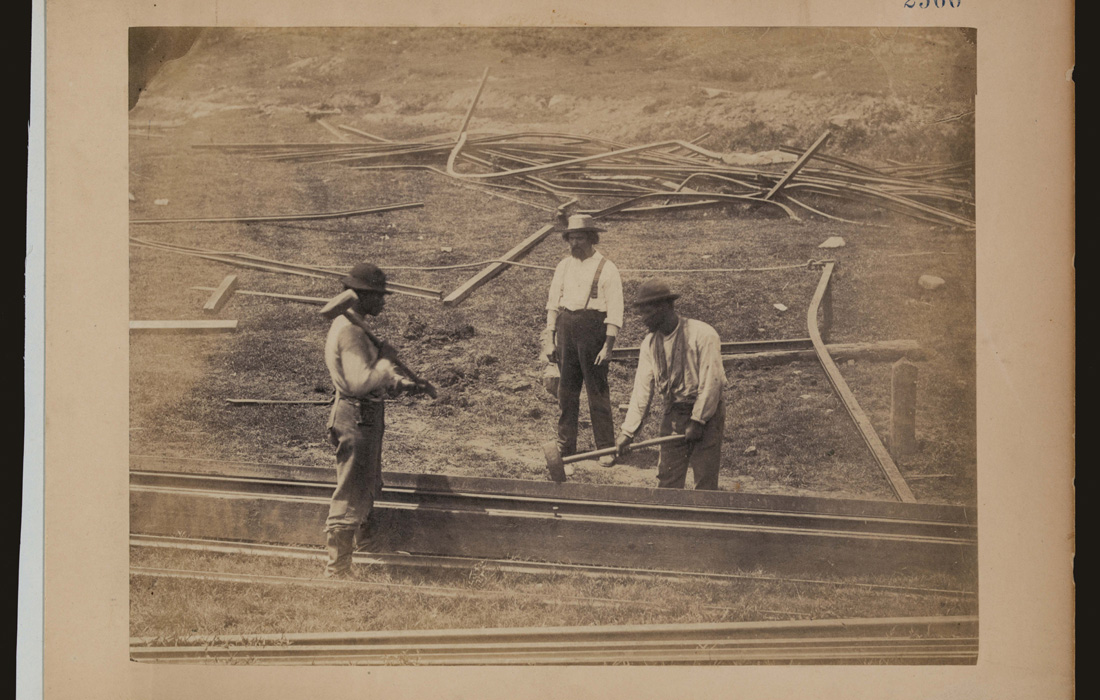 'Two railroad construction workers hammer track as third construction worker watches' by Andrew J. Russell; Library of Congress, LOT 9209, no. 66 [P&P]